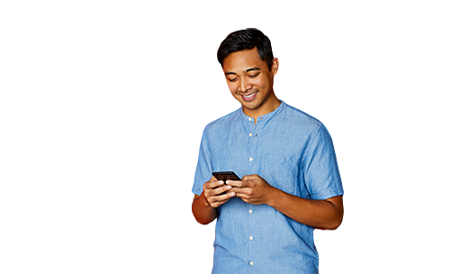 An image of a man holding a phone smiling